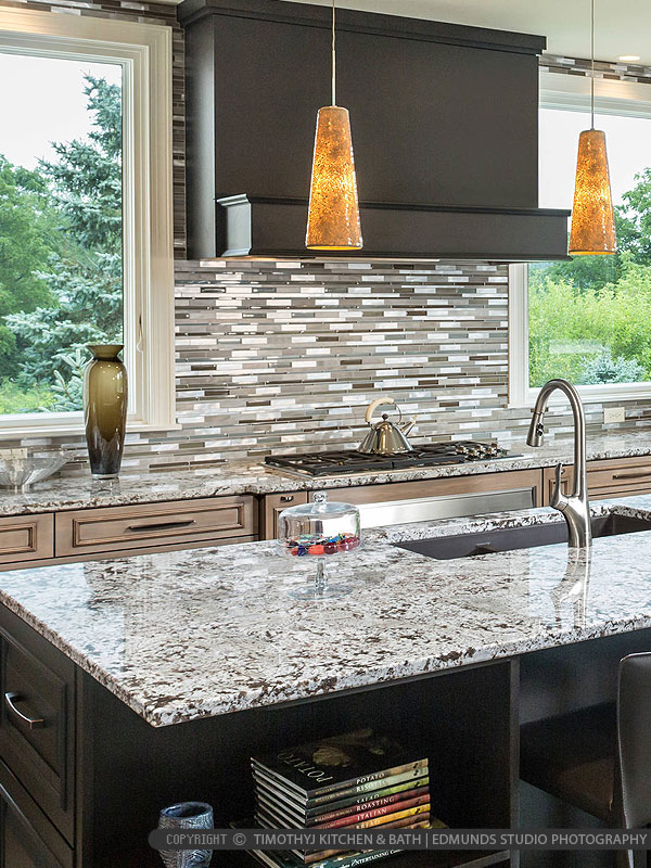 Glass Metal Backsplash Gray Granite Countertop Brown Cabinets