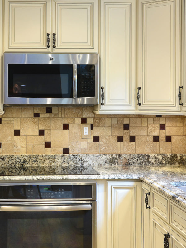 Beige cabinets granite countertop travertine glass backsplash tile 3 BA1043
