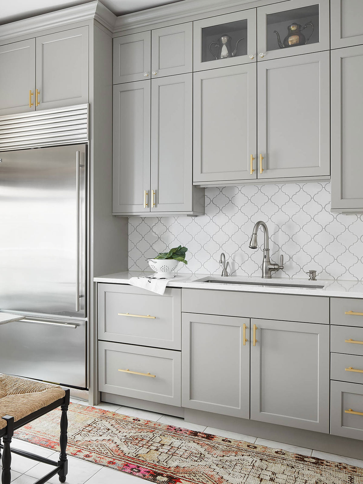 Modern gray cabinet with white arabesque backsplash tile 2