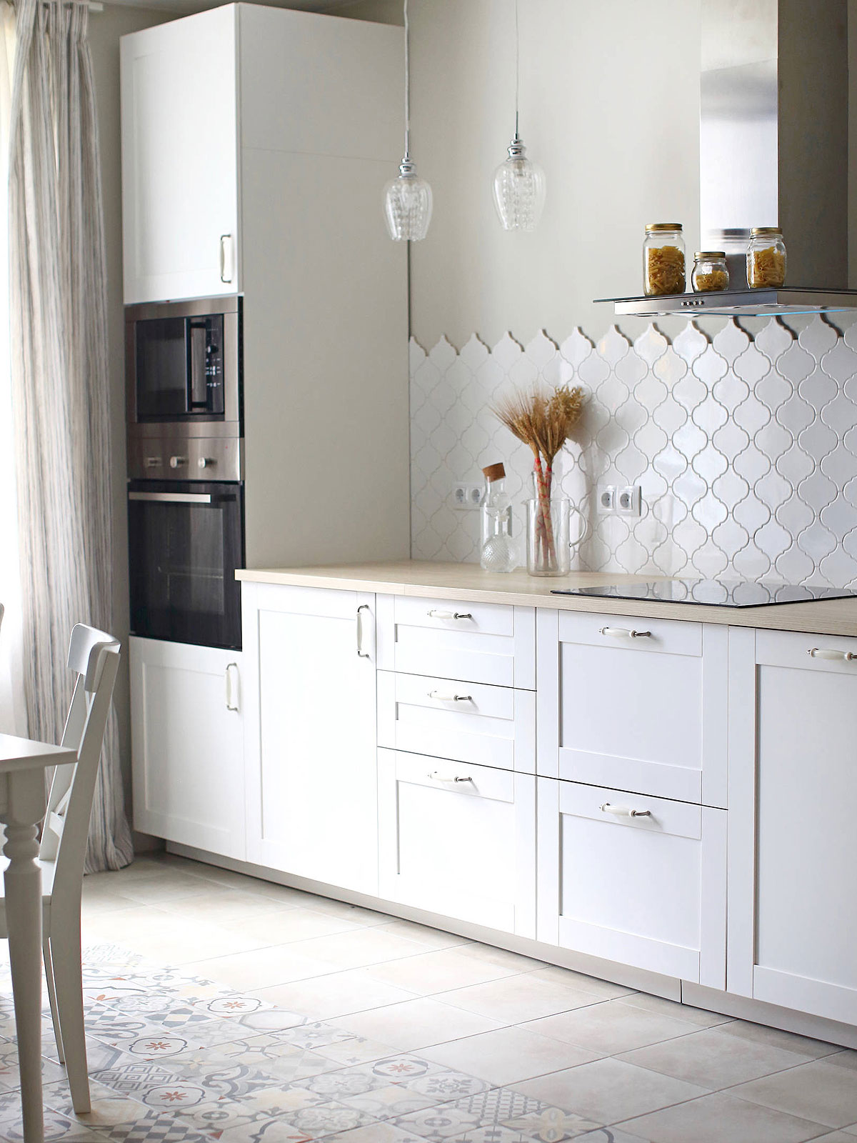 White arabesque backsplash tile white kitchen
