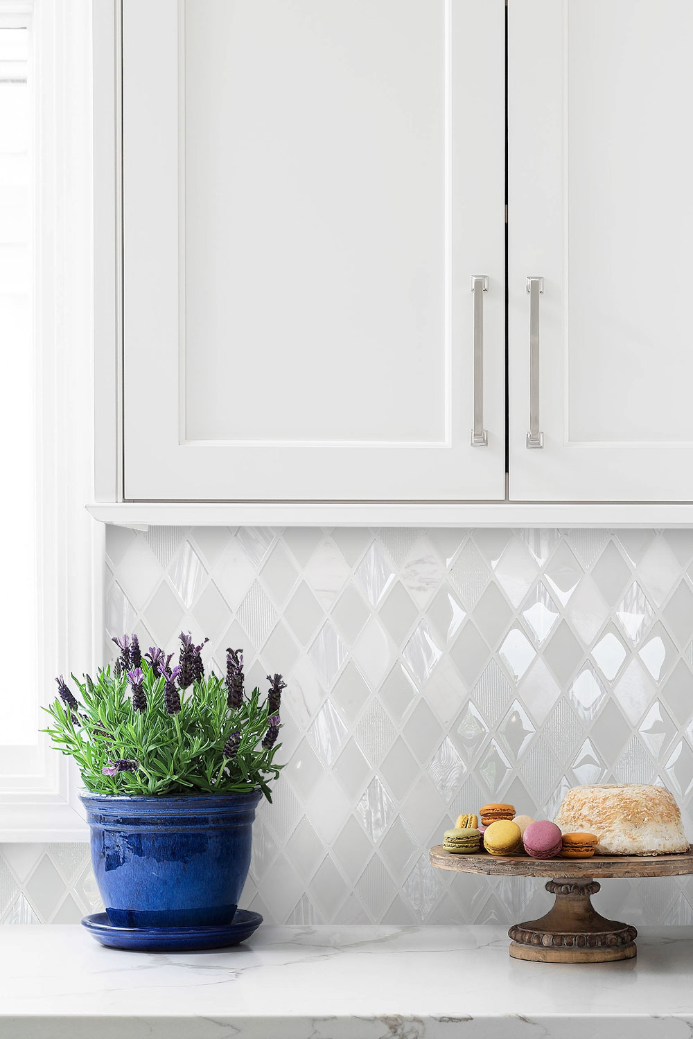 Marble Countertop White Cabinet And Backsplash